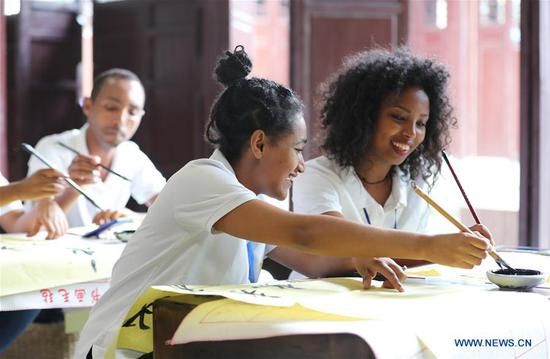 Ethiopian workers of ANTEX Fashion Group learn Chinese calligraphy at a library in Qianyuan Township of Deqing County, east China's Zhejiang Province, Aug. 30, 2018. In 2017, Zhejiang's ANTEX Fashion Group set a branch in Ethiopia. To build a better team, the Ethiopian branch has sent 93 Ethiopian workers to China for six-month training. Besides learning production skills, these workers also learnt Chinese language, calligraphy and martial art in spare time.