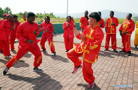 African students learn martial arts in Xinyu, east China's Jiangxi Province, Sept. 5, 2018. The Xinyu university set up courses of embroidery and martial arts for African students to learn about Chinese culture as the new semester begins. (Xinhua/Song Zhenping)