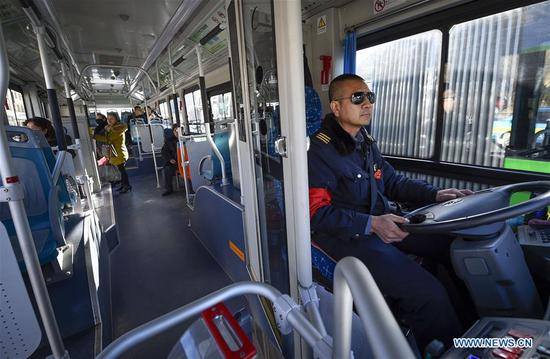 Bus driver Shao Hui is on duty in Yinchuan, northwest China's Ningxia Hui Autonomous Region, Feb. 4, 2019. It's the tenth year that Shao has stuck to his post during the Spring Festival. People from various industries stick to their posts on the eve of the Spring Festival which falls on Feb. 5 this year. (Xinhua/Feng Kaihua)