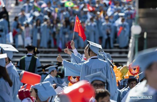 Graduate students from China pose for photos before the Columbia University Commencement ceremony in New York, the United States, May 22, 2019. The Columbia University Commencement ceremony of the 265th academic year took place on Wednesday. More than 17,000 students from Columbia's 18 schools and affiliates graduated this year. (Xinhua/Wang Ying)