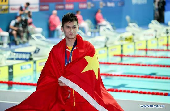 Sun Yang of China reacts during the medal ceremony for the men's 400m freestyle final at the Gwangju 2019 FINA World Championships in Gwangju, South Korea, July 21, 2019. (Xinhua/Bai Xuefei)