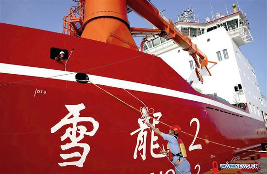 Workers help China's first domestically built polar icebreaker