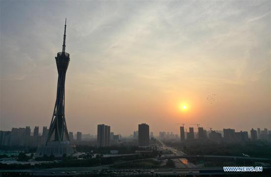 Aerial photo taken on Oct. 1, 2019 shows the FU Tower in morning glow in Zhengzhou, capital of central China's Henan Province. Celebrations for the 70th anniversary of the founding of the People's Republic of China (PRC) will be held Tuesday in central Beijing. (Xinhua/Li Jianan)