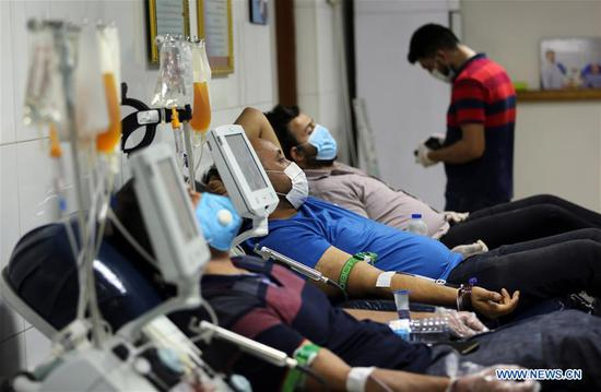 Patients recovered from COVID-19 donate plasma at the National Blood Transfusion Center in Baghdad, Iraq, June 28, 2020. The Iraqi Health Ministry on Monday said that 1,749 new COVID-19 cases are detected, bringing the total infections to 47,151, while up to 1,852 recoveries were registered during the day. (Xinhua/Khalil Dawood)