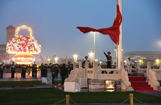 A flag-raising ceremony to celebrate the 71st anniversary of the founding of the People's Republic of China is held at the Tian'anmen Square in Beijing, capital of China, Oct. 1, 2020. (Xinhua/Ren Chao)