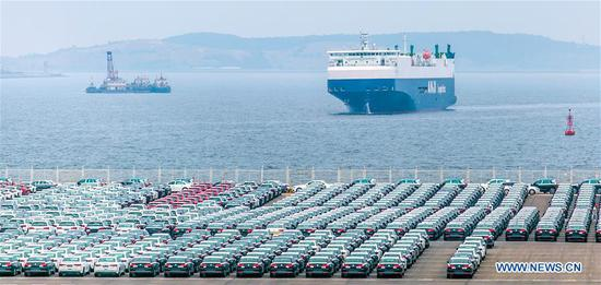 Photo taken on June 28, 2019 shows the vehicle terminal of Dalian Port in Dalian, northeast China's Liaoning Province. The 2019 Summer Davos Forum is held from July 1-3 in northeast China's coastal city of Dalian. Established by the World Economic Forum in 2007, the forum is held annually in China, alternating between the two port cities of Dalian and Tianjin. Summer Davos has been reshaping the landscape of Dalian's regional economy and strengthening the port's trade with other markets. Dalian has become an international city and a showpiece of China's reform and opening up. (Xinhua/Pan Yulong)