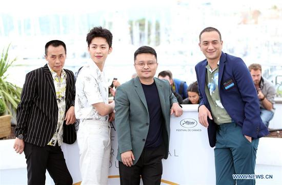Actor Huang Jue, director Bi Gan, actor Li Hongqi and actor Chen Yongzhong (From R to L) attend the photocall for