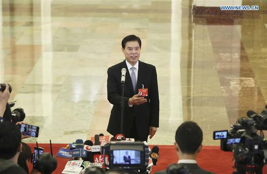 Minister of Commerce Zhong Shan receives an interview after the opening meeting of the second session of the 13th National People's Congress at the Great Hall of the People in Beijing, capital of China, March 5, 2019. (Xinhua/Yin Gang)