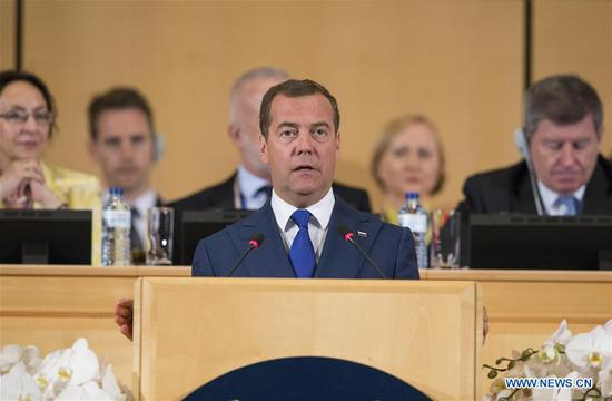 "Russian Prime Minister Dmitry Medvedev delivers a speech during the International Labour Organization (ILO)'s annual International Labour Conference in Geneva, Switzerland, June 11, 2019. Medvedev on Tuesday condemned ""illegitimate sanctions, protectionism and trade wars"" while addressing the ILO's annual International Labour Conference that runs from June 10-21, marking the 100th anniversary of the organization in Geneva. (Xinhua/Xu Jinquan)"