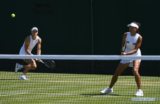 Zhang Shuai/Samantha Stosur (L) return a shot during the women's doubles first round match between Zhang Shuai of China/Samantha Stosur of Australia and Margarita Gasparyan/Alexandra Panova of Russia at the 2019 Wimbledon Tennis Championships in London, Britain, July 4, 2019. (Xinhua/Lu Yang)