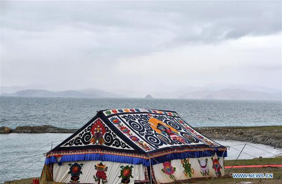 Photo taken on Aug. 7, 2019 shows a tent used for worshiping on the bank of Nam Co Lake in southwest China's Tibet Autonomous Region. (Xinhua/Chogo)