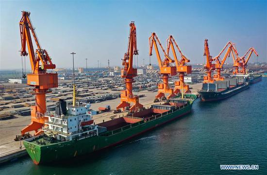 Aerial photo taken on Aug. 27, 2019 shows cargo ships berthed at a wharf of Wenfeng port in the China (Hebei) Pilot Free Trade Zone Caofeidian area in north China's Hebei Province. China (Hebei) Pilot Free Trade Zone (FTZ) Caofeidian area announced its inauguration on Saturday. Caofeidian area of the Hebei pilot FTZ focuses on industries including international commodity trade, port service, energy reserve and distribution, and high-end equipment manufacturing. (Xinhua/Yang Shiyao)