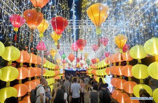 People view lanterns at a lantern fair celebrating the Mid-Autumn Festival at Victoria Park in Hong Kong, south China, Sept. 13, 2019. (Xinhua/Lu Hanxin)