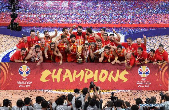 Team Spain celebrate during the awarding ceremony after the final match between Spain and Argentina at the 2019 FIBA World Cup in Beijing, capital of China, Sept. 15, 2019. (Xinhua/He Changshan)
