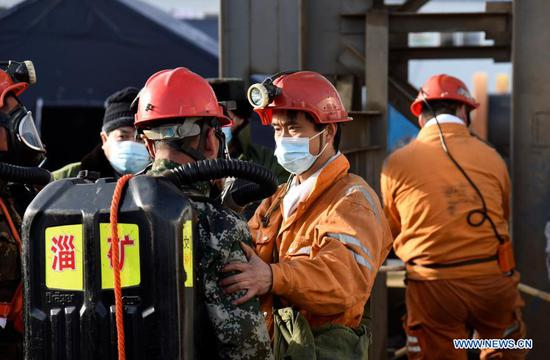 Rescuers are seen at the explosion site of a gold mine in Qixia City, east China's Shandong Province, Jan. 12, 2021. More than 300 rescuers have joined the search for 22 workers who were trapped underground after an explosion ripped through a gold mine under construction in Shandong, local authorities said Tuesday. (Xinhua/Wang Kai)