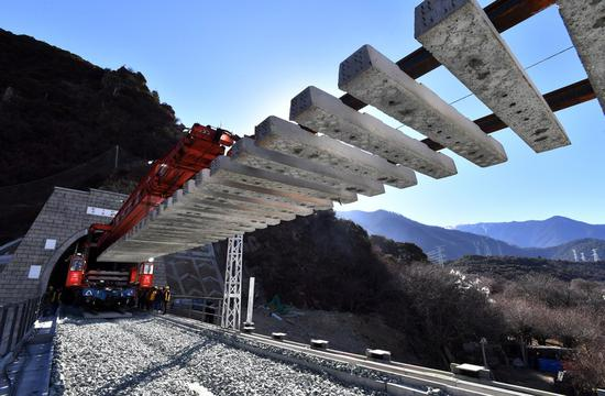 Photo taken on Dec. 27, 2020 shows the construction site of track-laying at a tunnel of Lhasa-Nyingchi section of the Sichuan-Tibet Railway in southwest China's Tibet Autonomous Region. (Xinhua/Chogo)