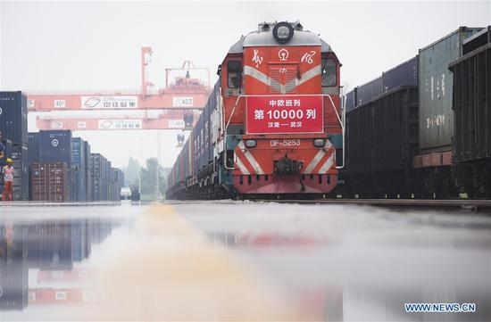 The freight train X8044 from Hamburg of Germany arrives at Wujiashan railway container center station in Wuhan, central China's Hubei Province, Aug. 26, 2018. As the freight train X8044 arrived in Wuhan, China-Europe freight trains have made 10,000 trips since 2011. (Xinhua/Xiao Yijiu)