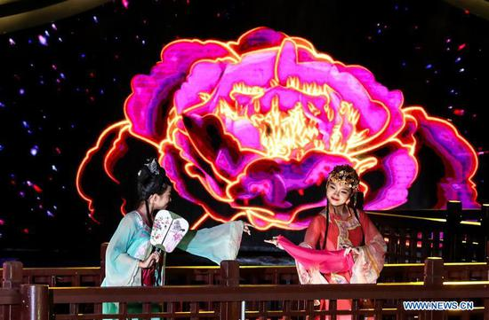 Actresses perform during a lighting ceremony of a lantern fair celebrating the Mid-Autumn Festival in Zhouzhuang Township of Kunshan City in east China's Jiangsu Province, Sept. 12, 2019. The lantern fair is held here from Sept. 12 to Oct. 8. (Xinhua/Yang Lei)