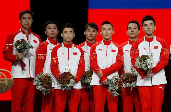 Members of silver medalist team China posed on the podium at the gymnastics world championships in Stuttgart, Germany, on Wednesday.