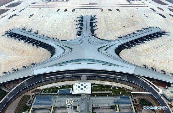 Aerial photo taken on March 25, 2020 shows the Jiaodong International Airport under construction in Qingdao, east China's Shandong Province. The construction work of the airport was fully resumed recently. (Xinhua/Li Ziheng)