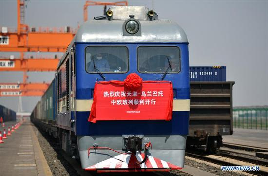 China-Europe freight train X9202 prepares to leave the Tianjin Pilot Free Trade Zone (FTZ) in north China's Tianjin Municipality, May 20, 2020. The freight train loaded with cars, accessories, food and clothing set off Wednesday from Tianjin to Ulan Bator of Mongolia. This was the first train on the China-Europe freight route that departed from the Tianjin Pilot Free Trade Zone since it was established in 2015. (Xinhua/Li Ran)