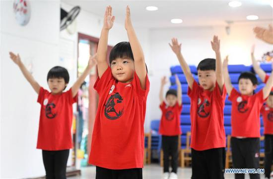 Children read books at a kindergarten in Zhengzhou, central China's Henan Province, June 2, 2020. In recent days, kindergartens in Zhengzhou have gradually reopened under COVID-19 prevention and control measures. (Xinhua/Hao Yuan)
