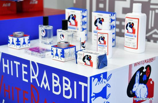 Photo taken on May 9, 2021 shows domestically produced cosmetic and fragrance products on display in the Provinces, Municipalities, Autonomous Regions of China Exhibition Hall during the first China International Consumer Products Expo in Haikou, capital of south China's Hainan Province. (Xinhua/Guo Cheng)
