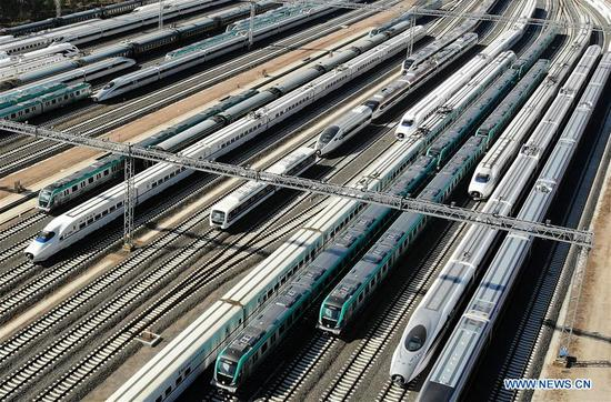Photo taken on May 10, 2018 shows rail vehicles produced by the CRRC Qingdao Sifang Co., Ltd. in Qingdao, a coastal city in east China's Shandong Province. Home to Tsingtao Beer and home appliance giant Haier, Qingdao is becoming a more attractive place to run important multilateral events. In June, the coastal city will host the 18th summit of the Shanghai Cooperation Organization (SCO). (Xinhua/Li Ziheng)