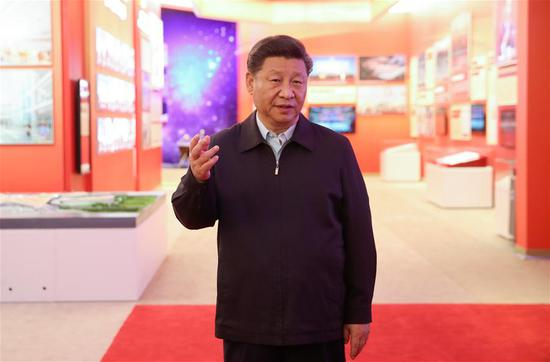 Chinese President Xi Jinping, also general secretary of the Communist Party of China (CPC) Central Committee and chairman of the Central Military Commission, speaks during a visit to an exhibition of achievements in commemoration of the 70th anniversary of the founding of the People's Republic of China (PRC) at the Beijing Exhibition Center in Beijing, capital of China, Sept. 23, 2019. Senior officials Li Keqiang, Wang Yang, Wang Huning, Zhao Leji, Han Zheng and Wang Qishan also visited the exhibition. (Photo by Sheng Jiapeng/Xinhua)