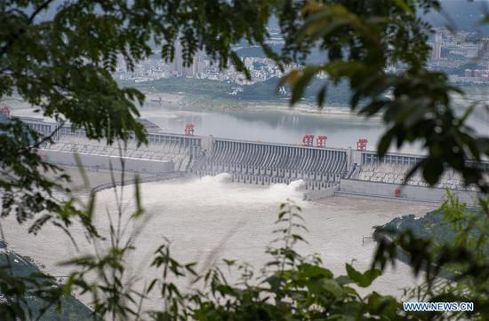 Photo taken on June 29, 2020 shows water gushing out from sluiceways of the Three Gorge reservoir on the Yangtze River in central China's Hubei Province. Due to heavy rain in the upper streams of the Yangtze River, the Three Gorge reservoir has been seeing an increase of inflow recently. (Xinhua/Xiao Yijiu)