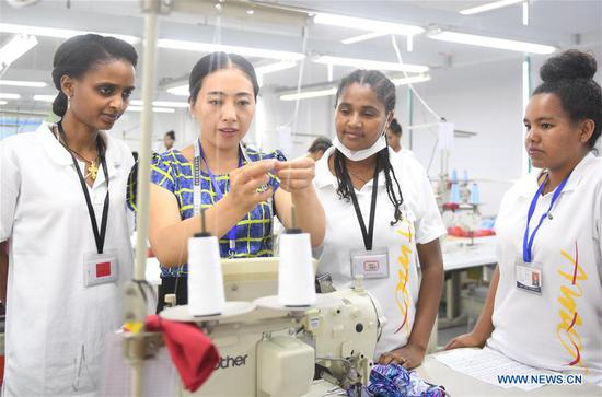 Ethiopian workers of ANTEX Fashion Group learn sewing skill at a plant in Huzhou, east China's Zhejiang Province, Aug. 30, 2018. In 2017, Zhejiang's ANTEX Fashion Group set a branch in Ethiopia. To build a better team, the Ethiopian branch has sent 93 Ethiopian workers to China for six-month training. Besides learning production skills, these workers also learnt Chinese language, calligraphy and martial art in spare time.
