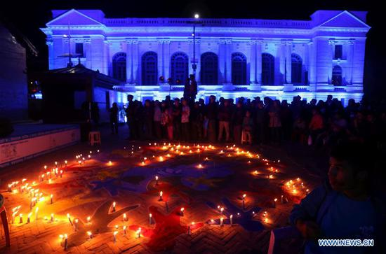 People participate in a candlelight event to call for care for autistic children to mark World Autism Awareness Day at Hanumandhoka Durbar Square in Kathmandu, Nepal, April 2, 2019. (Xinhua/Sunil Sharma)