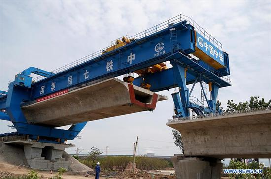 Photo taken on June 16, 2019 shows a box girder installation site on new Taiyuan-Jiaozuo high-speed railway in Shangtun Village of Boai County in Jiaozuo, central China's Henan Province. The first box girder in the Henan section of the railway was installed here Sunday, marking an important progress in the construction of the new high-speed railway linking Taiyuan, north China's Shanxi Province, and Jiaozuo in Henan. The 362-km railway line is expected to start service in 2020 with a designed speed of 250 kilometers per hour. (Xinhua/Li An)