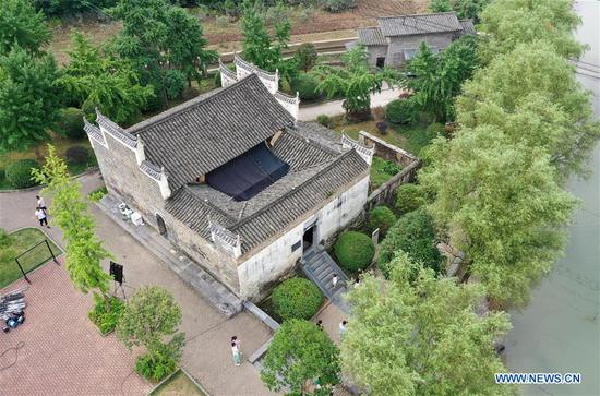 Aerial photo taken on June 29, 2019 shows the Sanguantang building complex which once served as the Red Army's command center during the 1934 Battle of Xiangjiang in Jieshou Town of Xing'an County, south China's Guangxi Zhuang Autonomous Region. The Battle of Xiangjiang in late 1934 is deemed by history experts as pivotal to a successful Long March of the Red Army led by the Communist Party of China (CPC) between 1934 and 1936. During the battle, the Red Army lost almost two thirds of its troops when crossing the Xiangjiang River from ferry points scattered in today's Guangxi Zhuang Autonomous Region, but managed to break through a military blockade line by the rival. By noon time on December 1, 1934, the main forces of the Red Army had all crossed the Xiangjiang River and the historic Long March was thus carried on. (Xinhua/Lu Boan)