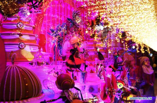 Children enjoy the Christmas window at Galeries Lafayette department store in Paris, France, Nov. 24, 2019. The city of Paris is decorated with Christmas trees and decorations for the festival season. (Xinhua/Gao Jing)