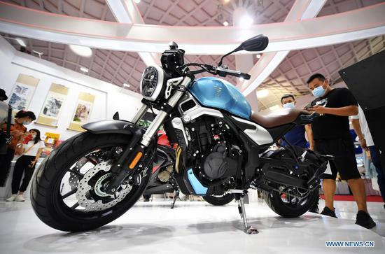 Photo taken on May 9, 2021 shows a domestically produced motorcycle on display in the Provinces, Municipalities, Autonomous Regions of China Exhibition Hall during the first China International Consumer Products Expo in Haikou, capital of south China's Hainan Province. (Xinhua/Guo Cheng)