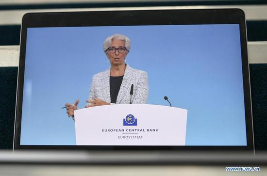 """Photo taken on June 10, 2021 shows the European Central Bank (ECB) President Christine Lagarde during the live streaming of a press conference following the ECB's governing council meeting held at the ECB headquarters in Frankfurt, Germany. The ECB said on Thursday that it will keep the euro area key interest rates unchanged and will continue buying bonds under its Pandemic Emergency Purchase Programme (PEPP) at a """"significantly higher pace"""" over the coming quarter than in the first months of this year. (Xinhua/Lu Yang)"""