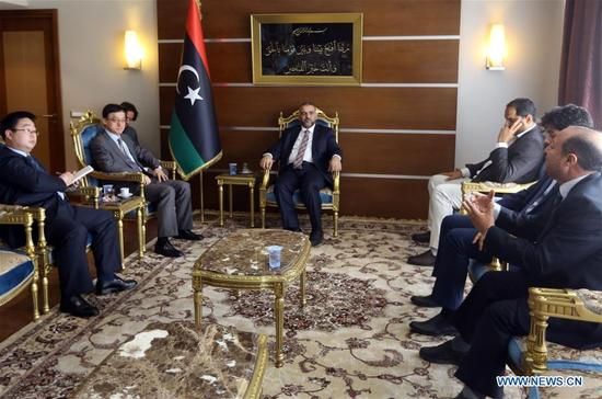 Chinese Charge d'Affaires to Libya Wang Qimin (2nd L) meets with Khaled al-Meshri (C), the newly-appointed head of the Libyan Higher Council of State in Tripoli, Libya, April 15, 2018. Chinese Charge d'Affaires to Libya Wang Qimin on Sunday said that China supports the political settlement in Libya as part of the UN-proposed action plan. (Xinhua/Hamza Turkia)