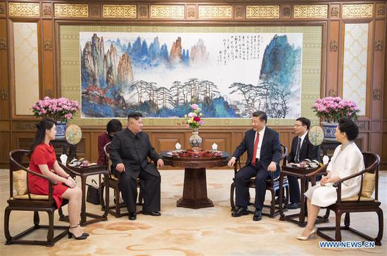 Xi Jinping (3rd R), general secretary of the Central Committee of the Communist Party of China (CPC) and Chinese president, meets with Kim Jong Un (3rd L), chairman of the Workers' Party of Korea (WPK) and chairman of the State Affairs Commission of the Democratic People's Republic of Korea (DPRK), at the Diaoyutai State Guesthouse in Beijing, capital of China, June 20, 2018. Xi's wife Peng Liyuan (1st R) and Kim's wife Ri Sol Ju (1st L) also attended the meeting. (Xinhua/Li Xueren)