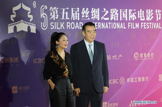 Director Chen Kaige (R) and actress Chen Hong attend the opening ceremony of the 5th Silk Road International Film Festival in Xi'an, capital of northwest China's Shaanxi Province, Oct. 8, 2018. The 5th Silk Road International Film Festival kicked off in Xi'an on Monday, with some activities hosted in its alternate counterpart Fuzhou, capital of southeast China's Fujian Province. (Xinhua/Shao Rui)