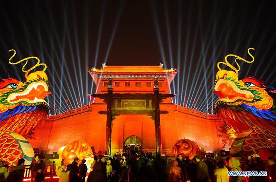 Tourists visit an ancient city wall in Xi'an, capital of northwest China's Shaanxi Province, Feb. 7, 2019. The city is in festive mood with its colourful lights at night during the Spring Festival. (Xinhua/Shao Rui)