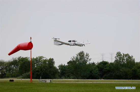 The Diamond DA42 aircraft which Zhang Bo drove for his flight around the world lands at an airport in Chicago, the United States, on June 9, 2019. After flying 68 days and making 50 stops, 57-year-old Bo Zhang completed his second around-the-world flight and landed in Chicago on Sunday morning. On April 2, Zhang kicked off the flight in the same airport in Chicago. In 68 days, he flied through 21 countries in three continents and over three oceans, with total mileage reaching 41,000 kilometers. (Xinhua/Wang Ping)