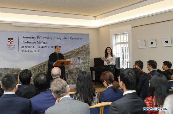 Chinese writer and Nobel laureate Mo Yan speaks during the Honorary Fellowship Recognition Ceremony at University of Oxford, Britain, on June 12, 2019. Mo Yan was awarded Wednesday the Honorary Fellowship by Regent's Park College, University of Oxford, in recognition of his contribution to Chinese and world literature. The college principal Robert Ellis presented the gown and stole to Mo at the ceremony. They unveiled together a new international writing center named after Mo. (Xinhua/Han Yan)