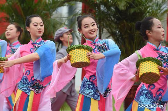 Artists perform during an event marking the conclusion of an activity that took journalists to retrace the route of the Long March, in Huining, northwest China's Gansu Province, Aug. 18, 2019. The activity, held from June 11 to Aug. 18, was aimed at paying tribute to the revolutionary martyrs and passing on the traditions of revolution. The Long March was a military maneuver carried out by the Chinese Workers' and Peasants' Red Army from 1934 to 1936. During this period, they left their bases and marched through rivers, mountains and arid grassland to break the siege of Kuomintang forces and continue to fight Japanese aggressors. Many marched as far as 12,500 km. (Xinhua/Luo Xiaoguang)