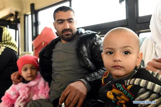 Syrian refugees are seen in a homebound trip from Lebanon to Syria at the Jdaidet Yabous border crossing, west of Damascus, Syria, on Feb. 13, 2020. Dozens of Syrian refugees returned home from Lebanon on Thursday, the state news agency SANA reported. (Photo by Ammar Safarjalani/Xinhua)