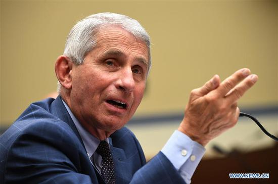 "Anthony Fauci, director of the U.S. National Institute of Allergy and Infectious Diseases, testifies at a House subcommittee hearing in Washington, D.C., the United States, on July 31, 2020. U.S. top infectious disease expert Anthony Fauci said on Friday he is ""cautiously optimistic"" that the United States would have a safe and effective COVID-19 vaccine this late fall or early winter. (Kevin Dietsch/Pool via Xinhua)"
