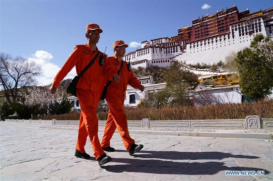 Firefighters patrol at the Potala Palace in Lhasa, southwest China's Tibet Autonomous Region, April 2, 2018. (Xinhua/Jigme Dorgi)