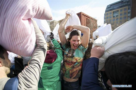 People participate in a pillow fight in Washington D.C., the United States, on April 7, 2018. (Xinhua/Ting Shen)