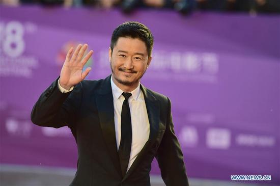 Wu Jing poses on the red carpet before the opening ceremony of the 8th Beijing International Film Festival (BJIFF) in Beijing, capital of China, April 15, 2018. (Xinhua/Liu Jinhai)