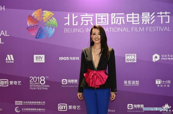 Hsu Chi poses on the red carpet before the opening ceremony of the 8th Beijing International Film Festival (BJIFF) in Beijing, capital of China, April 15, 2018. (Xinhua/Liu Xin)